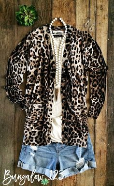 Fabulous Leopard print cardigan in a super-soft knit. Button-up style with two front pockets and ribbed hem. Excellent for year-round wear. 55% Cotton 45% Linen. Shown with the Cream/Tusk Shanlou Neck