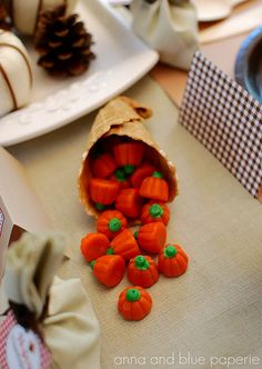 Waffle cones filled with candy pumpkins