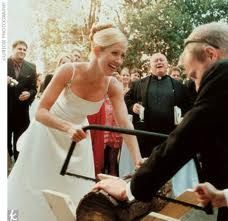 German wedding day tradition for a bride & groom to saw a log of wood. It symbolizes that in a marriage, you need to 'work together.'