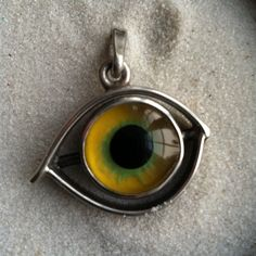 Glass Eye and Silver Pendant Mesmerizing by thecuriousbead on Etsy