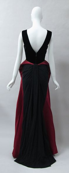 Charles James Evening dress 1946 The construction of this dress reconfigures the…