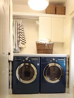 Stunning laundry room with LG Front Load Washer & Dryer in Bahama Blue, Ikea Pragel Countertop with white baluster legs, Ikea Adel Cabinets, beadboard backsplash, Home Depot shower curtain rod, MDF shelf and woven baskets.