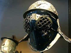 Helmet of a provocator (kind of gladiator) found in the ludus gladiatorius,the gladiator barracks in Pompeii. At the backside, a crack has been repaired.