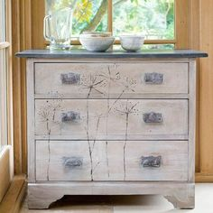 Annie Sloan Chalk Paint.  LOVE the dandelions on this!