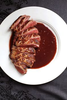 Magret à la D'Artagnan   SAVEUR  A rich pan sauce of reduced red wine, armagnac, and black truffle butter adorns seared duck breasts