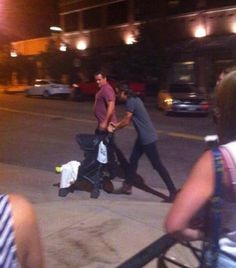 Harry and Lux. He's pushing her stoller. Repeat: HE'S PUSHING HER FUCKING STROLLER