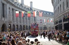 Thousands of spectators cheer on the Torch Relay along Regent Street in central London just a day before the opening ceremony