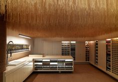 Add texture and softness to a retail boutique with a ceiling curtain made from coconut husk twine.