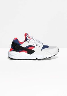 NIKE The Nike Air Huarache features a midsole with Air-sole unit for supreme, lightweight cushioning. Mesh, textile and synthetic leather are combined on the upper for a sleek, slightly retro design. Please note, this style runs small in size.
