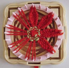 Woven Flower in Progress by knittingand, via Flickr
