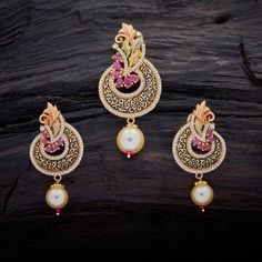 Stunning Design CZ Zircon Pendant-Earring Set studded with Ruby synthetic stones and pearl drops, with gold Polish.