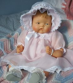 I think (?) this doll is ' Baby Dear ' a creation from the books by Eloise Wilken.
