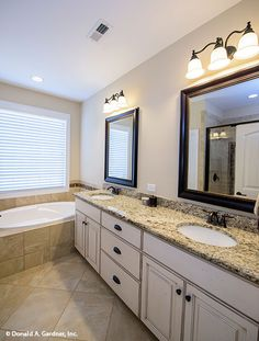 Master bathroom with dual vanities and a soaking bathtub. The Foxglove #1297. http://www.dongardner.com/house-plan/1297/the-foxglove. #Master #Bathroom #DreamHome