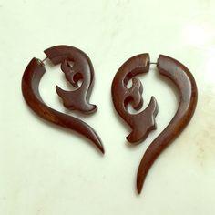 Faux gauge earrings Pretty badass faux gauge earrings! Hand carved wood, mahogany like color Jewelry Earrings