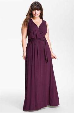 A maxi dress is a very fashionable statement and here the v-neck is very flattering for a larger chest and shoulder I'm not crazy about the belt but it does give definition to the waist. Also a subdued color is key and not crazy patterns otherwise it might look like you're trying to be 20. Wear with flats sandals and cardigan or blazer.