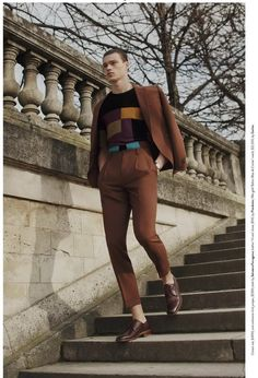 Filip Hrivnak has a geometric moment in a graphic jumper and brown tailored suit from Salvatore Ferragamo.