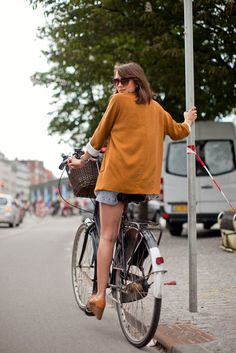 Why You Don't Have To Lower Your Style Standards If You're Biking #refinery29  http://www.refinery29.com/bike-outfits#slide-1  A vibrant blazer helps cover the back of your butt, while keeping you warm....