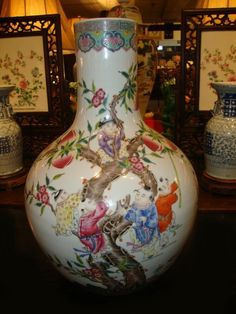 A rare important and most impressive Antique Chinese Porcelain Bottle Vase of the Qing Dynasty, Qianlong Period 1736 - 1795. (Circa 1740). Decorated in vividly coloured enamels depicting children frolicking among the branches of a Peach Tree.  This vase is in excellent condition, with no cracks, chips breaks or repairs.