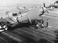 "Damaged TBM Avenger, March 1945. The outlined arrow on the tail (""G"" symbol) was not the design assigned by the Bureau of Aeronautics, but the ship's CO, CAPT Hall, believed it reduced aircraft visibility during night operations, at a time when his ship was operating as a night carrier."