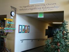 Love the entrance to this school (a great quote, and a tree with signs to direct guests)