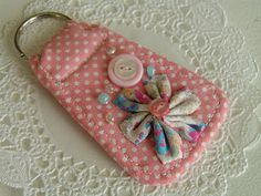 Fabric key ring. Could also make it with a name on it and put a clip instead of a keyring for a diaper bag name tag.