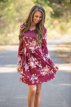 This beautiful floral dress is so easy to love all season long! We love the stunning floral print in burgundy, peach, jade green, pink, olive green, and white - it's such a delicate and beautiful combination!