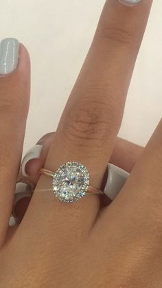 Oval halo diamond engagement ring in a solitaire band. Oval Halo Engagement Ring, Princess Cut Engagement Rings, Beautiful Engagement Rings, Designer Engagement Rings, Engagement Rings For Women, Expensive Engagement Rings, Oval Halo Ring, Crystal Engagement Rings, Most Popular Engagement Rings
