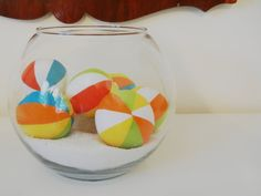 this might be too cute. beach ball in the sand centerpiece or decor for a beach reception or ebach themed wedding