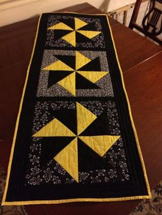 Black and yellow table runner made using Eleanor Burns' Merry Go Round block tutorial