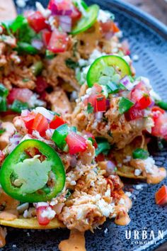 Leftover smoked chicken has met its match in this decadent Texas nacho recipe! Topped with homemade guacamole, fresh pico de gallo, and bound in an authentic coastal Mexican chipotle mayonnaise, this appetizer feeds a crowd and leaves them wanting more! This easy tex-mex recipe can also be made with a simple rotisserie chicken or pulled chicken from the deli. Get the recipe for Smoked Chicken Nachos now! | UrbanCowgirlLife.com Tailgating Recipes, Barbecue Recipes, Spicy Recipes, Grilling Recipes, Mexican Food Recipes, Real Food Recipes, Cooking Recipes, Quick And Easy Appetizers, Best Appetizers