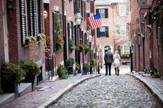 Brick buildings, cobble stone streets. Photo by Summer Street Photography.