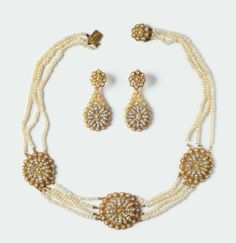 A seed pearls necklace and earrings montatura in oro giallo 750/1000 e perline - Cambi Casa d'Aste Srl - 17/03/2015