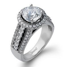 aSimon G. 18 Karat White Gold Ring With 0.51carats Total Weight Round And 0.47 carats Princess Cut Diamonds