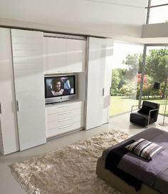 Contemporary wardrobe / glass / sliding door / with TV niche - Falegnami