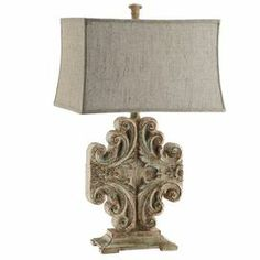 """Table lamp with a scrolling base and rectangular bell shade. Product: Table lampConstruction Material: Fabric and resinColor: Weathered creamFeatures: Rectangular fabric shade3-Way switch Accommodates: (1) 100 Watt bulb - not includedDimensions: 30"""" H x 18"""" W x 13"""" D"""