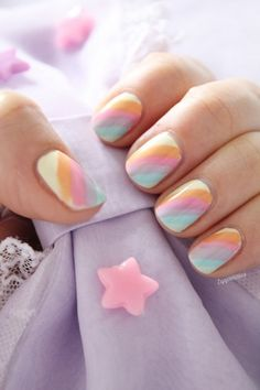 Diagonal stripe nail designs with light colors. Lovely nails while not distracting attention from your dress.