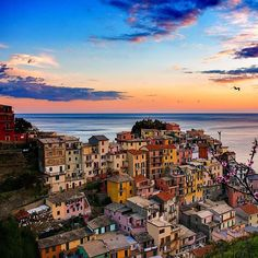 This gorgeous photo one of our followers shared by @sennarelax of the Cinque Terre #Italy - makes us want to jet over. Wow  #travel #sunrise #sky #skyteam #eurotrip #italia #coast #cappuccino #hiking #weekend #hike #sail #sea #seaside