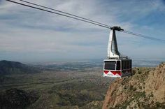 All aboard the Sandia tramway, elevation 11,000 ft. Dinner reservations at the peak tomorrow.