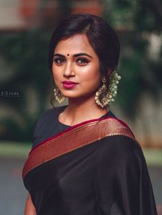 In a elegant black color saree and high neck elbow length sleeve blouse design Designer Sarees Wedding, Saree Wedding, Saree Blouse Patterns, Saree Blouse Designs, Blouse Styles, Beautiful Saree, Beautiful Indian Actress, Cotton Saree Designs, Saree Hairstyles
