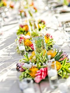 Gorgeous vibrant summer or destination wedding centerpieces {Michelle Garibay Events}