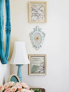 Wall Art - Using old maps as wall art carries the vintage vibe throughout the entire room. Simple frames add a touch of elegance. The more elaborate frame in the middle breaks up the other two similar frames while hinting at the use of blue in the room.