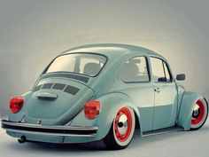 VW Beetle. Love the white wall tires and red rims!