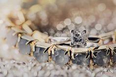 Macro photo of a wedding ring and bracelet