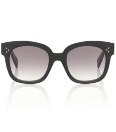 Hedi Slimane's rock'n-roll influence is felt with these black sunglasses from Celine Eyewear. Cut from acetate to an oversized D-frame silhouette, this Italian crafted pair is hallmarked with the house logo in gold . Black Sunglasses, Cat Eye Sunglasses, Round Sunglasses, Celine, Oversized Glasses, Round Ray Bans, Heart Frame, Double Breasted Blazer, Home Logo