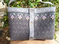 Sweater purse made from grey and purple recycled felted wool sweater. uses belt for strap