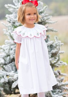 A classic look for your girl on Christmas morning and all holiday season long!  Hand embroidered Christmas trees adorn this sweet set.  . Poly-cotton blend, see size guide.