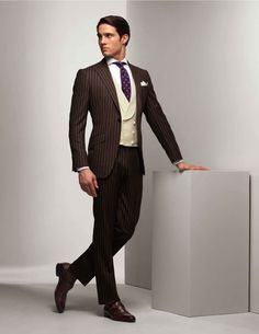 Google Image Result for http://cdn.gentlemansgazette.com/wp-content/uploads/2012/07/Brown-Chalk-Stripe-Suit-with-Double-Breasted-Vest.jpg