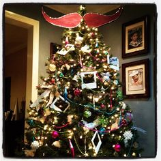 Hipster tree complete with a moustache tree topper and polaroid ornaments