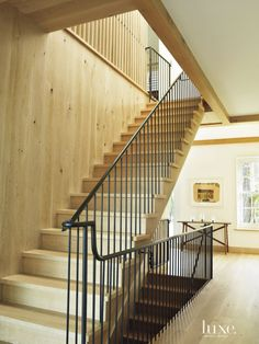 Transitional Neutral Staircase with Bronze Handrail