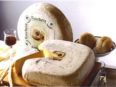 Raschera is an Italian cheese that comes from Cuneo. Its name is derived from Lake Raschera, which lies at the foot of Mt Mongioie. It is a semi-soft cheese made from sweet cow's milk. The flavour of Raschera changes from season to season. Spring and summer cheeses are sweet, fresh and slightly tart. Winter cheeses are more solid and vibrant. Raschera has a round or square shape with reddish-yellow crust.